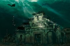 Shicheng City (literally, Lion City). The city of nearly 1,339 years of age, situated in east China's Zhejiang Province, has been submerged under Qiandao Lake since 1959 for the construction of the Xin'an River Hydropower Station. International archeologists vividly named the city submerged in water 'time capsule.' Stairs in ancient houses, walls, and memorial arches remain the same as they were thousands of years ago. water, bucket list, ruin, lakes, places, lions, diving, atlantis, china