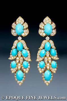 VAN CLEEF & ARPELS  An extravagant pair of turquoise and diamond pendant earrings,  of oriental inspiration, each of stylised foliate design, set with cabochon turquoises and brilliant cut diamonds, mounted in 18 karat yellow gold.