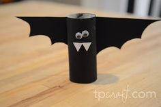 A bunch of halloween toilet paper crafts>>I tried this with the girls I nanny-and it was perfect!  Instead of painting the paper towel roll black, we just wrapped black construction paper around it.  We also used different colored wings to make each one a little different from the other!  We also put string through the middle of the roll to then hang it.  We had flying colorful bats!