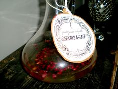 This pomegranate champagne recipe looks delicious!  I love the idea of labeling the drinks drink, dinner parties