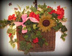 "Willow Basket with handle , you can hang the basket, or sit it as shown in pictures........SO Pretty, has greenery and red geraniums, with Burlap Flower....... 18"" tall, 11"" long, and 4"" wide.....$29.99"