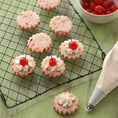 Festive Cherry-Almond Ornament Cookies are perfect for holiday parties! Recipe: http://www.bhg.com/recipe/cookies/cherry-almond-ornament-cookies/?socsrc=bhgpin100512cherryalmondornamentcookies