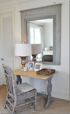 {Cote de Texas: Ginger Barber Designed Townhouse}  desk and Kooboo wicker chair, antique trumeau