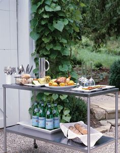 Countryliving.com-Summer-Garden-Party-stainless-steel-Serving-trolley-Table.gif 360×460 pixels