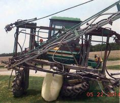 John Deere 6000 sprayer salvaged for used parts. Call 877-530-4430. We buy salvage farm equipment. 7 salvage yards in the Midwest. http://www.TractorPartsASAP.com