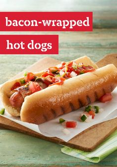 Bacon-Wrapped Hot Dogs -- Cook the hot dogs and bacon at the same time on the grill or in a skillet. This recipe couldn't be easier!