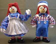 "Fabriche Raggedy Ann and Andy dolls from Kurt Adler, 7.5"" Clothing is stiffened cotton."
