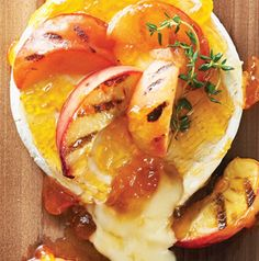 Brie with Peaches, Fresh Thyme and Garlic Toasts is a Test Kitchen favorite! Serve as an appetizer or even as a dessert. peach