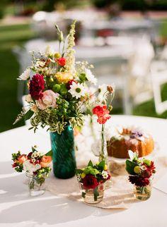 Colored vases & mini mason jars for centerpieces. @Bridget Adams