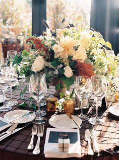 this is a gorgeous and lush table arrangement by the Green Vase