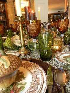pretty for fall---Brown and green, lace tablecloth with brown transferware edge plates, brown and green glasses.