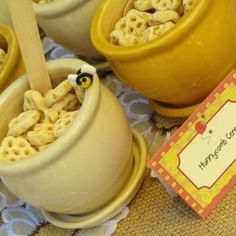 Honey pots of honeycomb-cereal.