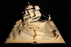 From Within a Book…  Ship book sculpture using a book called 'Ships & Sailing: Tales of the Sea'    http://fromwithinabook.tumblr.com/