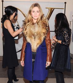 @Who What Wear - Olivia Palermo   The fashion week all-star donned a jaw-dropping Diane Von Furstenberg coat paired with studded Rebecca Minkoff booties.