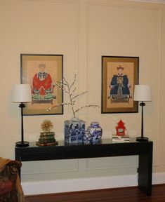 Console table style, with Ancestor Portraits (okay so not this client's ancestors, but someones!) custom grasscloth parsons console table, new buffet lighting, old and new ginger jars, and funky red pagoda lantern. Maybe a couple of bench seats and plant to complete the look? #ancestorportraits #circalighting #alcottbentley #livenupdesign #wisteria #gingerjar #cherryblossom #parsonstable