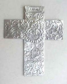 A cross made from craft foam and foil