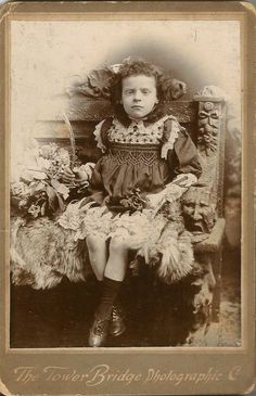 """A picture of a boy named George, forced into a frilly dress. The basket he's holding contains bay leaves, which in the Victorian language of flowers means """"I change but in death"""". His twin sister died and his parents wanted a keepsake of her so this was the nearest they could get. I imagine they found comfort in it, but it seems quite strange to me."""