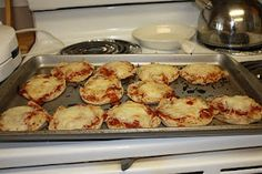 English muffin pizza...Bake at 400 degrees for 15 minutes or so until cheese is melted.