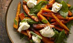 Orange-roasted carrots with rocket and ricotta