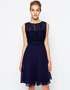 We love this pretty navy dress for Fall bridesmaids
