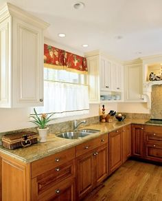 white upper cabinets with stained wood lowers