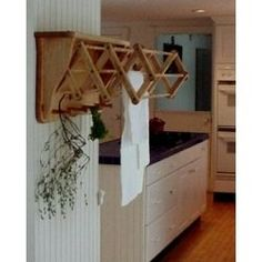 wooden clothing lines pictures | ... Racks - Pullout Wooden Clothes Drying Rack from Stacks and Stacks