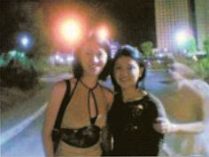 This interesting photo was taken sometime around the year 2000 in Manilla, Republic of the Philippines. According to The Ghost Research Society, two girlfriends were out for a walk one warm night. One of them entreated a passing stranger to photograph them using her cell phone's camera (hence the low-resolution picture). The result is shown here, with a transparent figure seeming to tug on the girl's arm with a firm if friendly grip.