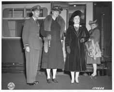 Eleanor Roosevelt greeted by King George and Queen Elizabeth at Paddington Station upon arrival in England. Malvina Thompson in background. October 23, 1942.