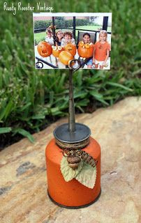 Oil Can Pumpkin sparked an idea to use baby food jars either paint them or fill them with something pretty then add the wire photo holder, can cover the lid with fabric to make it cute