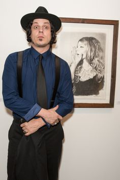 """""""OMG, she can speak!"""" Jack White is startled by a painting at the opening of artist Mercedes Helnwein's The Trouble With Dreams exhibit on Oct. 5 in Los Angeles"""