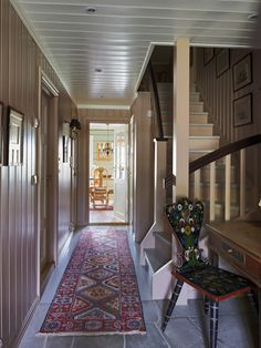 Love the rug in this farmhouse hallway!