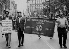 Dr. Isarael (center) in a Labor Day parade of the 1960s.
