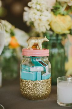 gold glitter dipped jar // photo by Jason + Anna Photography // http://ruffledblog.com/woodsy-catskills-wedding