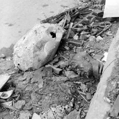 An image almost too-perfectly symbolic of Berlin in the last weeks of April 1945: a crushed globe and a bust of Hitler lying amid rubble and debris outside the Reich Chancellery building.