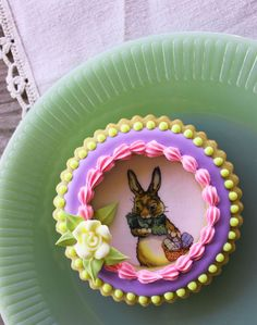 """Really cool idea..The bottom cookie is decorated using the wafer papering technique and pre-printed bunny wafer paper; then a window frame, aka a cookie ring with icing trim, is """"glued"""" on top with thick Royal Icing."""