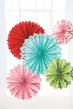 Party decorations get a pop of color with hanging paper flowers.