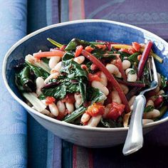 """Quick White Bean Stew with Swiss Chard and Tomatoes  Low in fat but high in protein, beans are one of Joe Bastianich's favorite ingredients. He uses white beans here, but he also loves making this recipe with chickpeas and flat gigante beans: """"The bigger and creamier the beans, the better."""""""