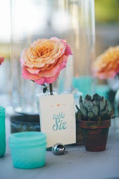 #table-numbers  Photography: Daniel Lateulade - daniellateulade.com  Read More: http://www.stylemepretty.com/2014/07/21/coral-aqua-whimsical-garden-wedding/
