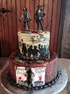 Our wedding cake ! ( well , it was the Groom's cake, but I ate most of it !!! ) We love the Walking Dead ! We gave our action figures to the decorator and they had fun with them ! Cake by Debbie's Delights