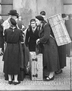 1938: Refugees arriving in Prague after leaving their homes in the Sudetenland, a region with a large ethnic German population, which was the object of German expansionism