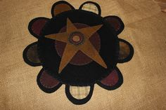 Cute primitive star wool penny rug