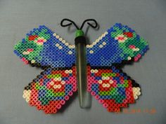 I made this with Perler beads, pipe cleaner, the handle of a fork, and wooden bead