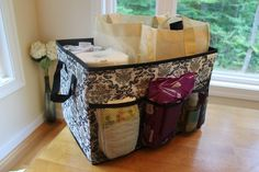 Storage basket that lives in your vehicle. Great idea to help with keeping things organized when travelling - especially with a toddler and baby!