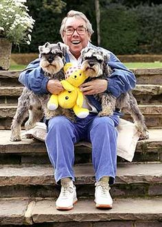 Ronnie Corbett a Scottish actor and comedian with his Miniature Schnauzers Rag and Muffin.
