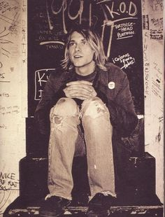 When long hair on boys was hot. Pictures of Kurt Cobain Looking Happy.