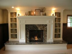 raised hearth fireplace makeover - ugly marble here, but the idea is good for us... covering up the concrete hearth