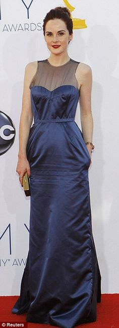 British invasion: Downton Abbey actress Michelle Dockery was on the prowl in a satin Louis Vuitton gown