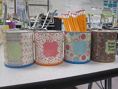 Reuse formula containers with scrapbook paper for a cute organizer for the classroom. or fabric