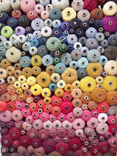 colorful spools of yarn