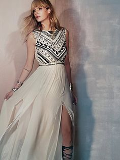 Beaded Silk Chiffon Gown   Silk chiffon maxi gown with intricate black bead embellishment on front and around waist. Low scoop back with cutout opening at lower back. Zips up left side of dress. Fully lined. Top layer of skirt portion has two tall slits on the front. A dramatic and gorgeous piece made to turn heads.  *By Mara Hoffman Wedding Dressses, Freepeople, Silk Chiffon, Mara Hoffman, Dresses, People Beads, Free People, Chiffon Gowns, Beads Silk